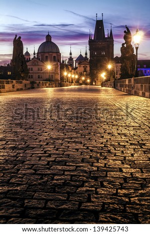 Charles Bridge in Prague at dawn; Czech Republic - stock photo
