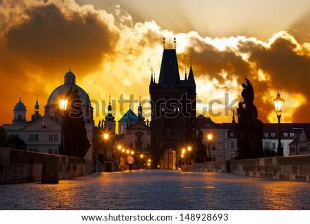 Charles Bridge in Prague (Czech Republic) at dawn  - stock photo