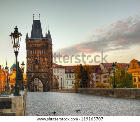 Charles bridge in Prague early in the morning at sunrise time - stock photo