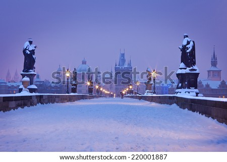 Charles Bridge in winter morning in pastel tones, Prague, Czech Republic - stock photo