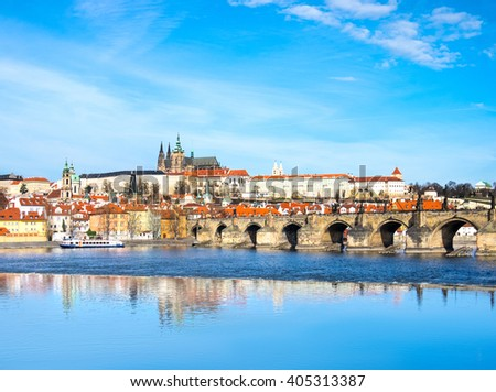 Charles Bridge, St. Vitus Cathedral and other historical buildings in Prague, panorama from the opposite river bank - stock photo