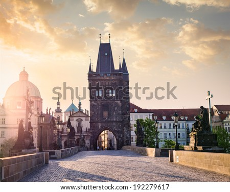 Charles bridge tower in Prague on sunrise, Czech Republic - stock photo