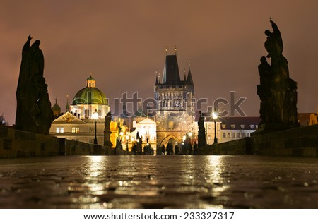 Charles bridge with light reflected from wet cobblestone. Prague  - stock photo