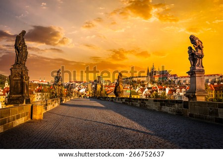 Charles bridge with statues and Prague castle on surise. Prague, Czech Republic - stock photo