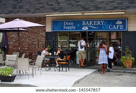 CHARLESTON - JUL 22: Customers entering and eating at the Dixie Supply Bakery & Cafe in Charleston, SC. Featured on Diners, Drive-Ins and Dives on the Food Network channel July 30, 2012. - stock photo