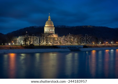 CHARLESTON, WEST VIRGINIA - DECEMBER 17: West Virginia State Capitol building from across the Kanawha River on December 17, 2014 in Charleston, West Virginia - stock photo