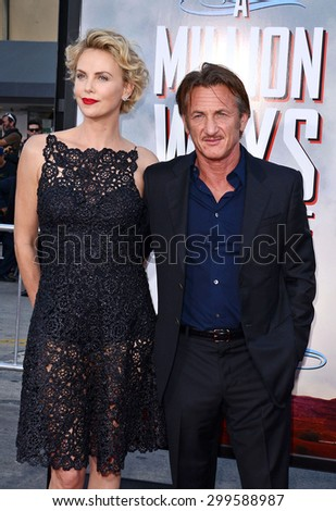 "Charlize Theron and Sean Penn at the Los Angeles premiere of ""A Million Ways To Die In The West"" held at the Regency Village Theatre in Los Angeles, United States, 150514.  - stock photo"