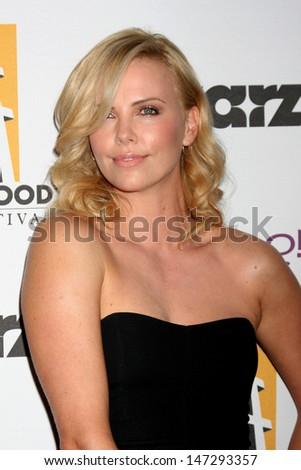 Charlize Theron arriving at the 13th Annuall Hollywood Film Festival Awards Gala Ceremony Beverly Hilton Hotel Beverly Hills,  CA October 26, 2009 - stock photo