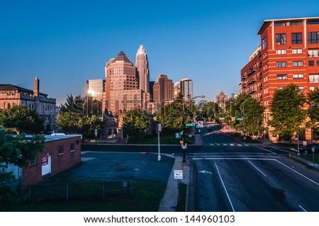 charlotte city skyline in daylight with carolina blue sky - stock photo