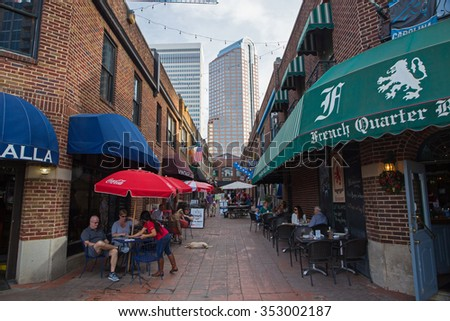 CHARLOTTE, NC - December 12, 2015: The restored open-air Brevard Court and enclosed Latta Arcade (background) provide unique shopping and dining options in downtown Charlotte, North Carolina. - stock photo