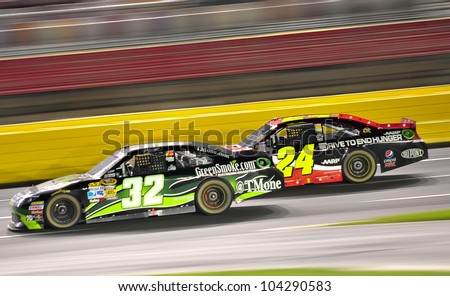 CHARLOTTE, NC - MAY 27:  Jeff Gordon 24 is passing TJ Bell 32 at the Nascar Coca Cola 600  at Charlotte Motorspeedway in Charlotte, NC on May 27, 2012 - stock photo