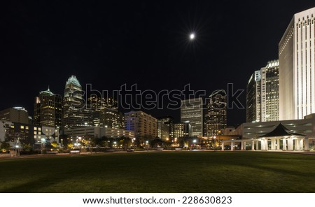 Charlotte, North Carolina city skyline at night as seen from Romare Bearden Park - stock photo
