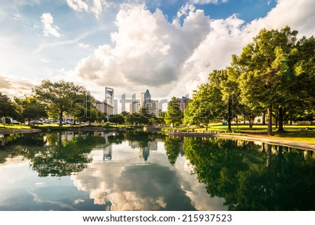 Charlotte, North Carolina skyline with the reflection of the clouds and buildings in the water. Taken from Marshall park.  - stock photo