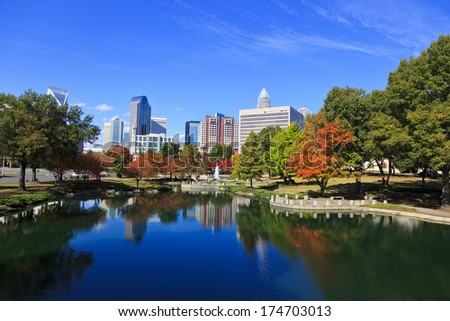 Charlotte skyline from Marshall Park in the fall.  The new Skye condos are in the middle. - stock photo