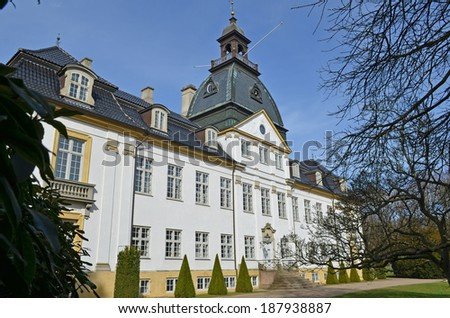 Charlottenlund Palace on a sunny day is a former royal summer residence in Charlottenlund, some 10 km north of central Copenhagen  - stock photo