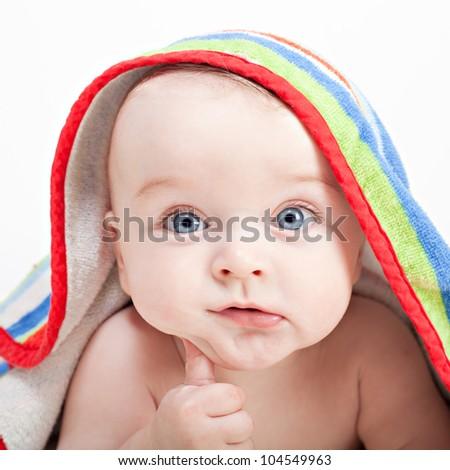 Charming baby boy in bathrobe with a hood - stock photo