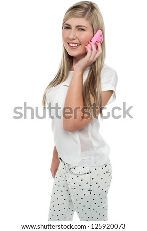 Charming blonde female communicating with her friend on the mobile. - stock photo