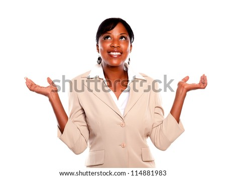 Charming businesswoman with arms up and looking up on isolated background - stock photo