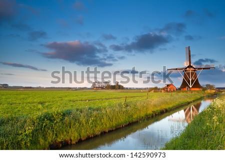 charming Dutch windmill at sunrise, Groningen, Netherlands - stock photo