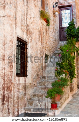 Charming entrance of courtyard of old mediterranean village Spili - stock photo
