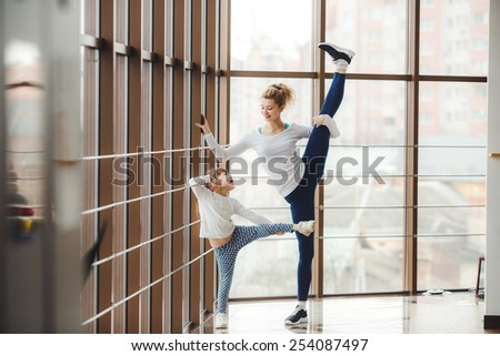 Charming family spends time in the gym - stock photo