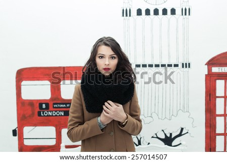 Charming fashion female modell in a coat. - stock photo
