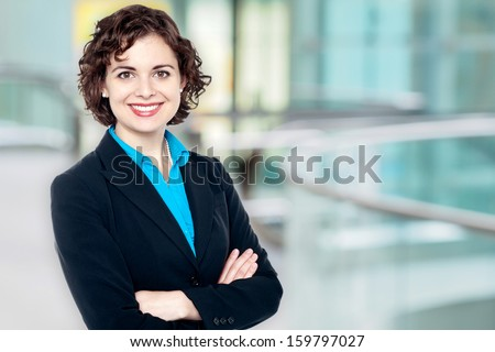 Charming female executive posing confidently - stock photo