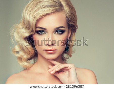 Charming girl blonde curly hair . Beautiful fashion model. - stock photo