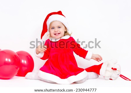 Charming girl happy Christmas gifts on white background - stock photo