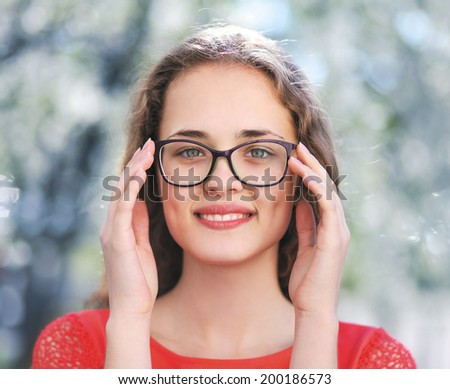 Charming girl in glasses - stock photo
