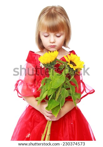 Charming girl in white and blue dress.Happy childhood, children's fashion concept. - stock photo