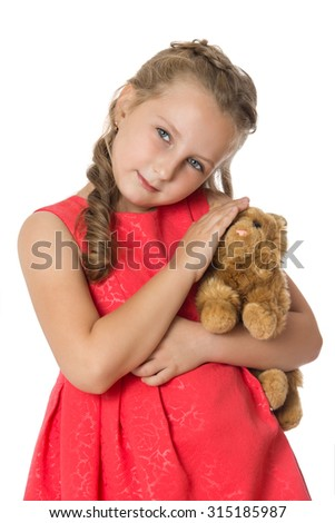 Charming girl of school age holding a soft toy that she Stokes. Closeup-Isolated on white background - stock photo