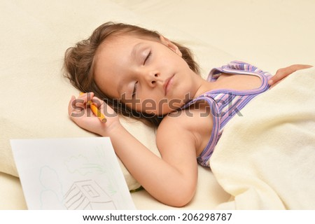 Charming little girl sleeping in her bed at home - stock photo