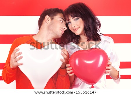 Charming love couple with heart-shaped balloon - stock photo
