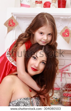 Charming mother and daughter laughing and playing on Holiday - stock photo