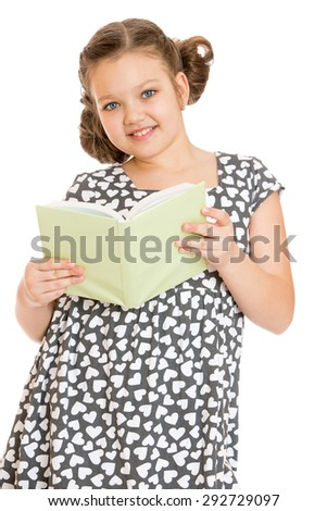 Charming schoolgirl dreaming in a gray silk dress opened the book to read , close-up - isolated on white background - stock photo