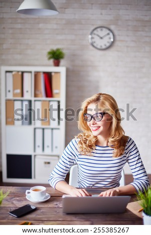 Charming secretary working in office - stock photo