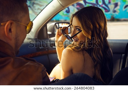 Charming sexy young blonde woman smiling to her boyfriend. Inside photo - stock photo