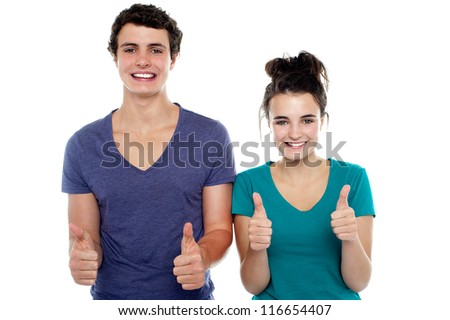 Charming showing thumbs up sign to camera. All the best - stock photo