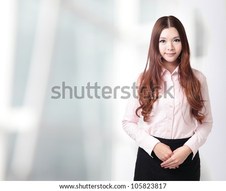 charming smile face of a beautiful business woman at office, model is a asian beauty - stock photo