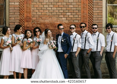 Charming smiles of the couple with the friends on the wedding - stock photo