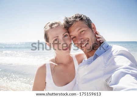 charming smiling couple with selfportrait - stock photo