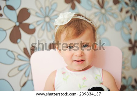 charming smiling girl on chair - stock photo