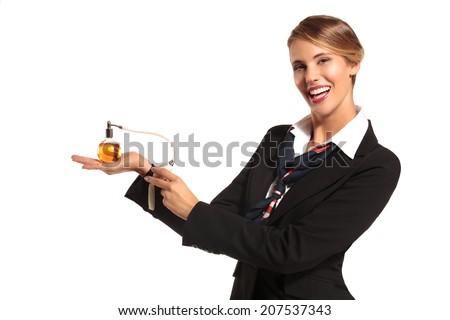 Charming  stewardess showing perfume - stock photo