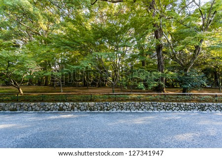 Charming street on my way to Kinkakuji Temple (The Golden Pavilion) in Kyoto, Japan - stock photo