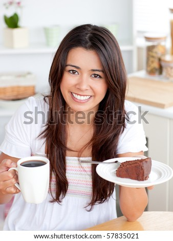 Charming woman holding a cup and a plate in her hands - stock photo
