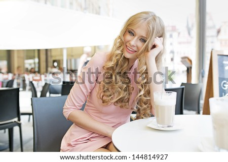 Charming woman in a cafe - stock photo
