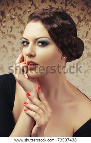 Charming woman touching lips beauty retro style portrait - stock photo