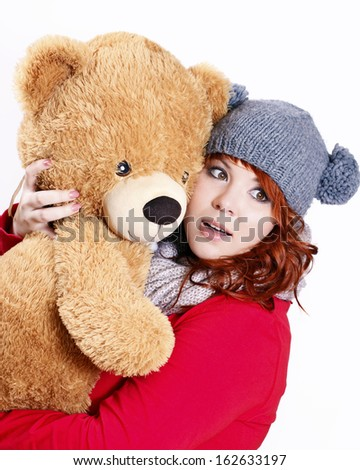 Charming woman with her teddy bear - stock photo