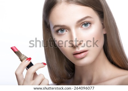 Charming young babe with lipstick and light makeup. Picture taken in the studio.Beauty face - stock photo